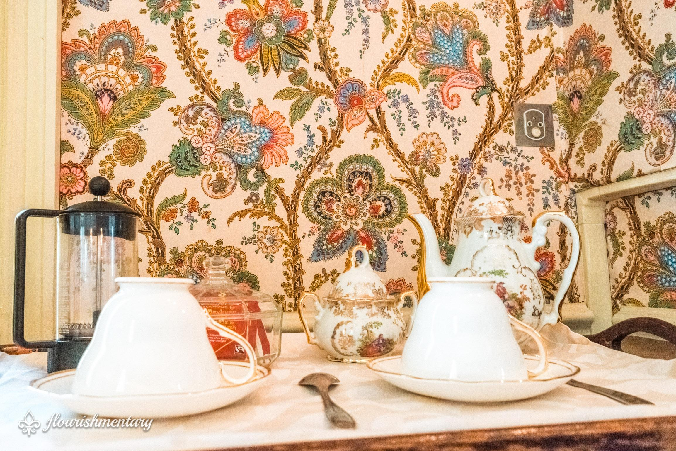 persian wallpaper and teacups chateau de lalande